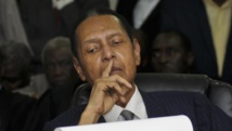 L'ancien président haïtien Jean-Claude Duvalier lors de l'énonciation des charges contre lui par la cour d'appel de Port-au-Prince, le 28 février 2013. REUTERS/Swoan Parker