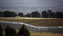 Le village de Ar Rafide en Syrie, vu du côté israélien de la frontière entre les deux pays. AFP PHOTO/MENAHEM KAHANA