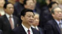 Le vice-président Xi-Jinping se lève pour l'hymne national chinois à la fin d'une conférence à Pékin en mars 2012.