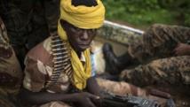 Des combattants de l'ex-Seleka en route vers un village à 25 kilomètres de Bambari, le 25 mai 2014. REUTERS/Siegfried Modola