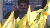 Hassan Nasrallah, le chef du Hezbollah libanais, s'adressant à ses partisans via un écran géant lors d'un rassemblement à Aita el-Chaab le 16 août 2013. REUTERS/Ali Hashisho