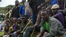 Des membres de l'ex-rébellion du M23 devant le camp de Ramwanja, le 17 décembre 2014. AFP PHOTO/ ISAAC KASAMANI