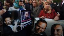 Manifestation de soutien aux deux journalistes enlevés, le 8 novembre dernier à Tunis. AFP PHOTO / FETHI BELAID