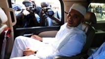 Karim Wade à son arrivée à l'audition devant la Cour de répression de l'enrichissement illicite à Dakar, le 15 mars 2013. AFP/SEYLLOU