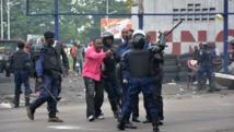 Depuis plusieurs jours, des violences font rage à Kinshasa. AFP PHOTO/ PAPY MULONGO