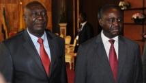 Michel Djotodia (g.) et l'ex-président centrafricain François Bozizé (d.), ici le 11 janvier 2013. AFP PHOTO / STEVE JORDAN