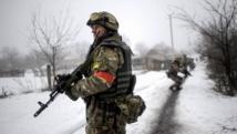 Une patrouille militaire ukrainienne dans un village de la région de Lougansk, le 28 janvier 2015. REUTERS/Maksim Levin