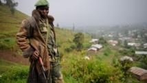 Un rebelle du M23 sur les hauteurs de Bunagana, en juillet 2012. AFP PHOTO / PHIL MOORE