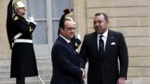 Une rencontre entre François Hollande et Mohammed VI qui met un terme à une année de brouille diplomatique entre le Maroc et la France, au palais de l'Elysée à Paris, le 9 février 2015. REUTERS/Philippe Wojazer