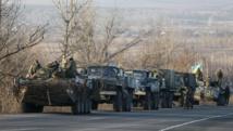 Des soldats ukrainiens près de Artemivsk, dans l'Est du pays, le 13 février 2015. REUTERS/Gleb Garanich