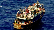 Migrants aficains cherchant à rejoindre les côtes italiennes en août 2014. AFP PHOTO / MARINA MILITARE