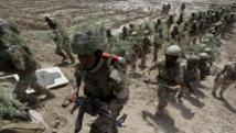 Des membres des forces de sécurité irakiennes à l'entraînement, le 9 avril à Jurf al-Sakhar. REUTERS/Alaa Al-Marjan