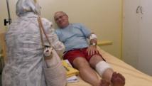 A l'hôpital Sahloul de Sousse, un touriste anglais blessé lors de l'attaque terroriste du 26 juin 2015. AFP PHOTO/FETHI BELAID