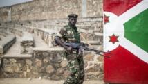 Les mesures de sécurité ont été renforcées au Burundi à la veille d'élections controversées. Ici un militaire patrouillant le 27 juin 2015. AFP PHOTO/MARCO LONGARI