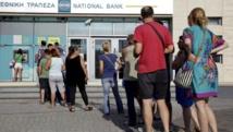 Depuis vendredi et l'annocne d'un référendum, les Grecs ont massivement retiré leur argent dans les banques du pays. REUTERS/Stefanos Rapanis