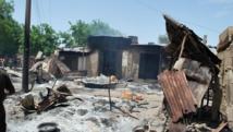 Des maisons brûlées par Boko Haram lors de l'attaques du village de Zabarmari, près de Maiduguri, au Nigeria, le 4 juillet 2015. STRINGER / AFP