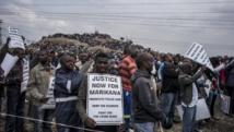Trois ans après le drame de Marikana, les mineurs et les familles demandent toujours justice. AFP PHOTO/MARCO LONGARI