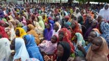 Des Nigérians ayant fui les violences dans le nord-est du pays à Maiduguri, dans l'Etat de Borno, le 3 août. AFP PHOTO/STRINGER