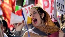 Une manifestante crie des slogans en faveur de l'indépendance du Sahara occidental, lors d'un rassemblement à Madrid, en novembre 2014. AFP PHOTO/ JAVIER SORIANO