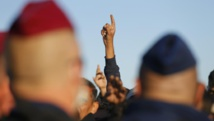 Les migrants font face aux forces de l'ordre hongroises, ce 7 septembre à Roszke. REUTERS/Laszlo Balogh