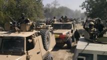 Des éléments de l'armée tchadienne dans les rues de Gambaru, au Nigeria, le 4 février 2015. Près de 2 000 soldats tchadiens seraient aujourd'hui dans la régionde Diffa pour combattre Boko Haram. REUTERS/Stringer