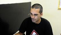 Le rappeur et militant des droits de l'homme Luaty Beirao, ici en 2012, est jugé avec 16 autres militants. AFP PHOTO / STEPHANE DE SAKUTIN