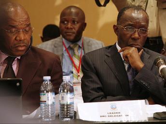Les responsables du M23 et du gouvernement congolais (ici sur la photo) lors des négociation de Kampala, en octobre 2013. AFP PHOTO / ISAAC KASAMANI