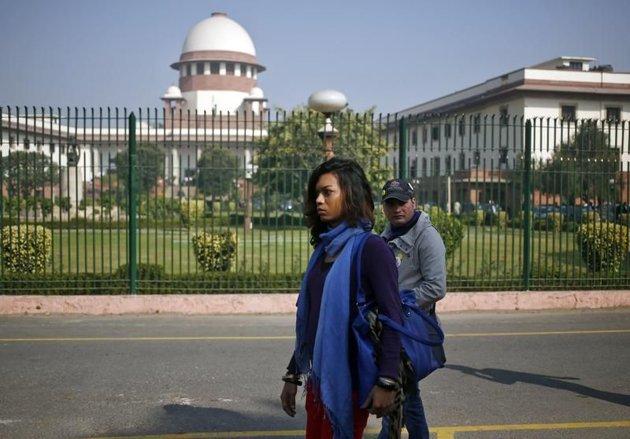 Liberation.fr/Libération.fr - Des défenseurs des droits homosexuels se rendent à la Cour suprême d'Inde, à New Delhi le 11 décembre.