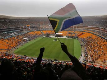 Le stade Soccer City au début de l'hommage à Nelson Mandela, le 10 décembre 2013. REUTERS/Yannis Behrakis
