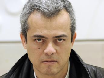 Roberto Pesle, fils du prêtre Etienne, disparu sous la dictature chilienne en 1973. Paris, 2010. AFP PHOTO / MIGUEL MEDINA