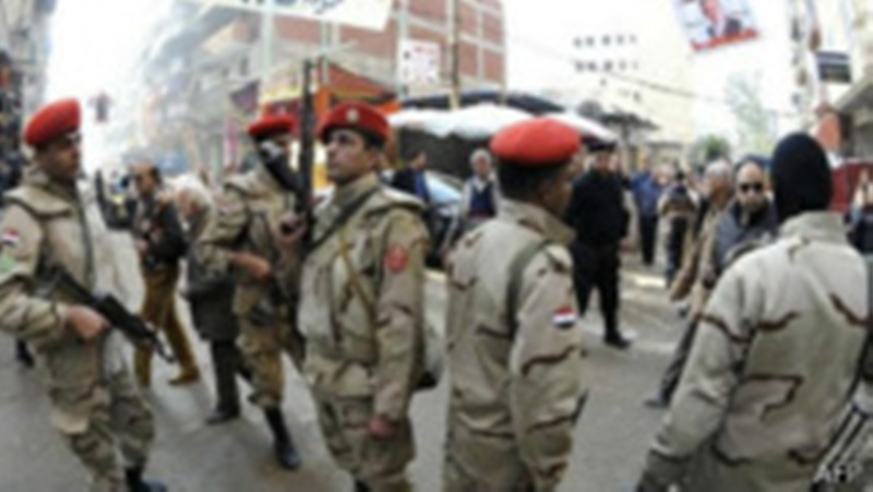 Des membres des forces armées égyptiennes déployés dans les villes lors des dernières élections, au mois de janvier.