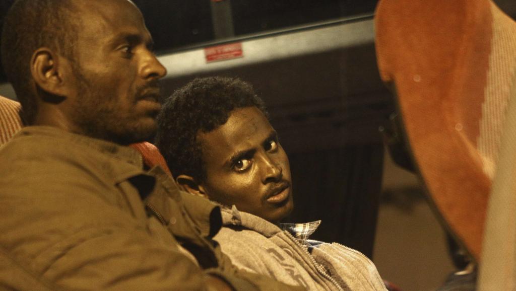 Un migrant au port d'Augusta, en Sicile, ce 9 avril 2014. Selon la marine italienne, près de 4 000 personnes, des migrants, ont été secourues en 48 heures. REUTERS/Antonio Parrinello