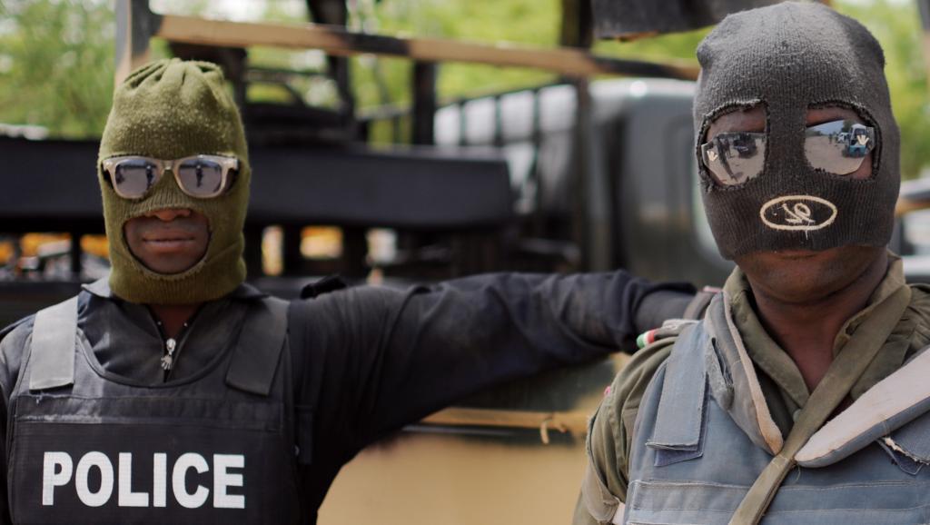 Des policiers nigérians, à Maiduguri, dans l'Etat de Borno, au Nigeria, lors d'une opération contre Boko Haram en juin 2013. AFP PHOTO / Quentin Leboucher