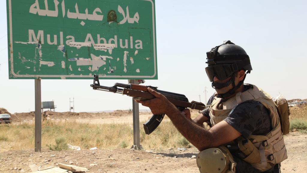 Patrouille des forces de sécurité kurdes dans la banlieue de Kirkouk, le 14 juin 2014. REUTERS/Azad Lashkari