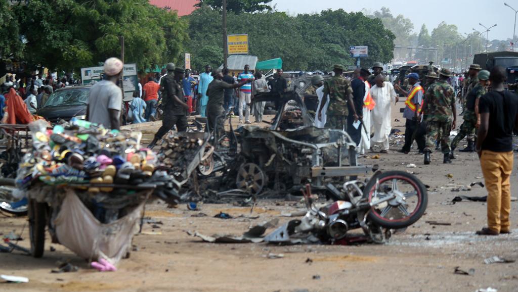 Une rue de Kaduna dévastée après le double attentat meurtrier, le 23 juillet 2014 AFP PHOTO / VICTOR ULASI