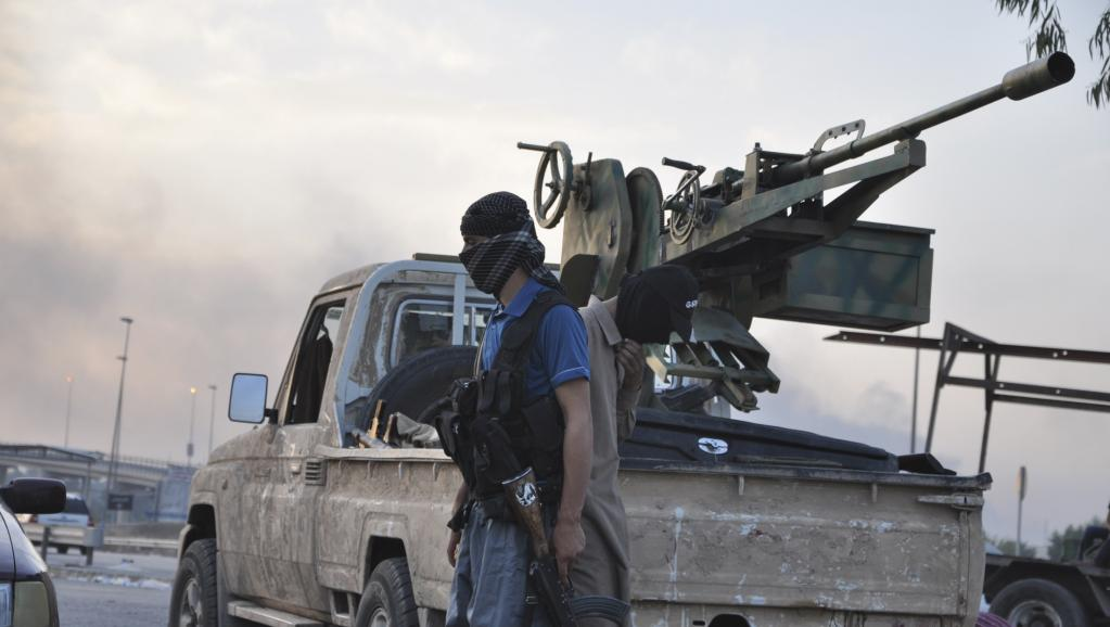 Combattants de l'Etat islamique à Mossoul, le mercredi 11 juin 2014. REUTERS/Stringer