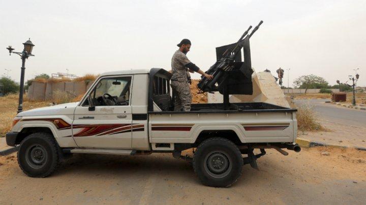 © Mahmud Turkia, AFP | Les stigmates des combats entre milices rivales à Tripoli (Archives)