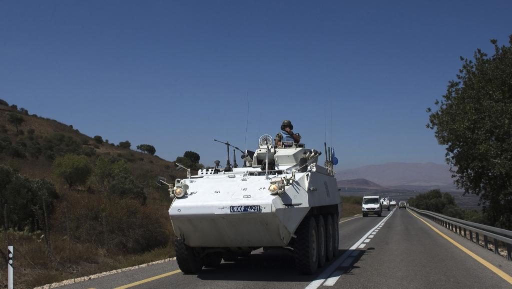 Ces casques bleus appartiennent à l'Undof, la Force de l'ONU chargée de l'observation du désengagement entre la Syrie et Israël sur le plateau du Golan. REUTERS/Ronen Zvulun