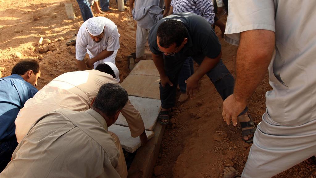 Funérailles du jeune Tawfik Bensaud, militant des droits civiques, assassiné à Benghazi, le 20 septembre 2014. AFP/Abdullah Doma