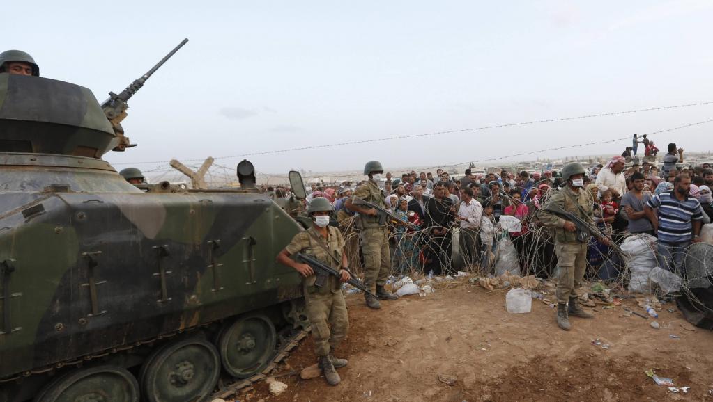 Militaires turcs à la frontière avec la Syrie le 27 septembre 2014. REUTERS/Murad Sezer