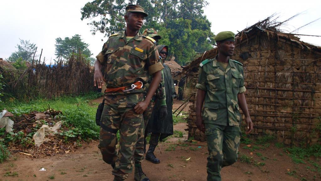 Charismatique, surmédiatisé, le colonel Mamadou Ndala (g) dérangeait au sein des FARDC. AFP PHOTO / ALAIN WANDIMOYI