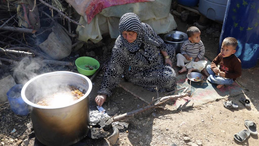 Des réfugiés syriens dans la vallée de la Bekaa, au Liban, le 16 octobre 2014. Près de 1,2 million de Syriens se son réfugiés au Liban. REUTERS/ Mohamed Azaki