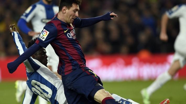 Le Barça régale face à l'Espanyol , Messi bat des records