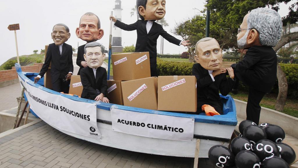 Les présidents des pays grands pollueurs et mauvais payeurs épinglés par les ONG de défense de l'environnement qui manifestaient en marge de la COP20 à Lima, le 14 décembre. REUTERS/Enrique Castro-Mendivil
