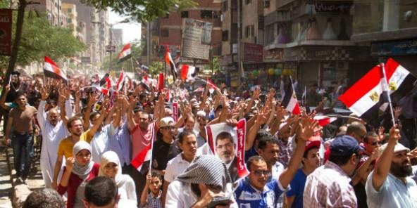 Membres des Frères musulmans manifestant deux ans après la grande répression de 2013. © Belal Darder/AP/SIPA