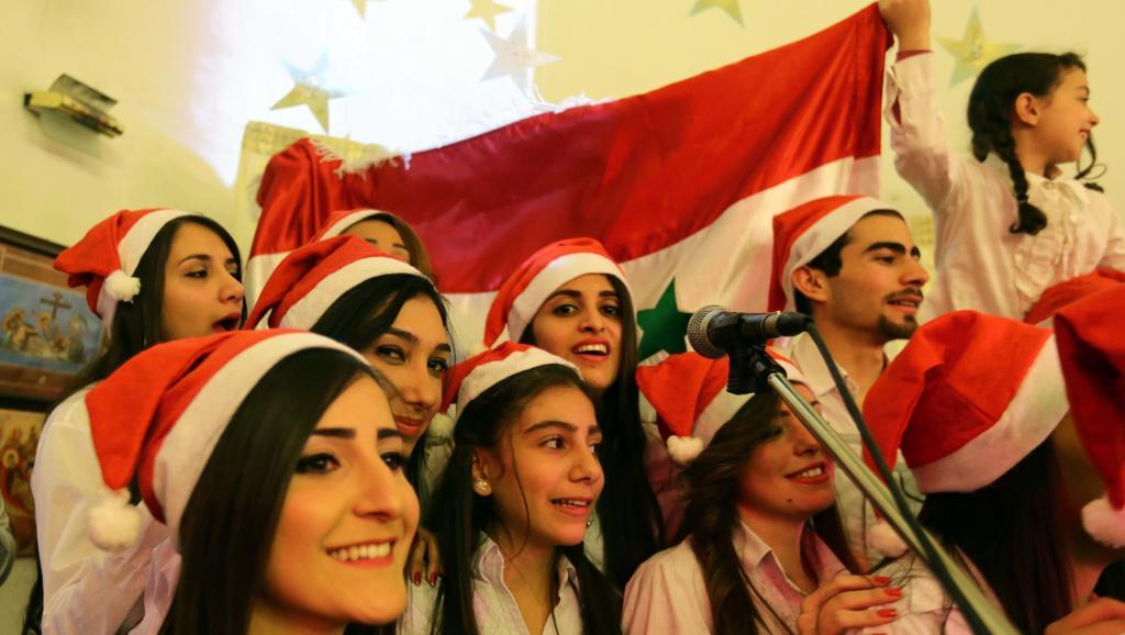 Des chrétiens syriens pendant un concert de Noël dans l'église Ibrahim al-Khalil à Damas. LOUAI BESHARA / AFP